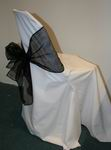 White chair cover with black bow