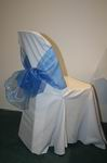 White chair cover with blue bow