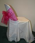 White chair cover with pink bow