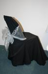 Black chair cover with silver bow