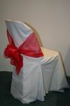 White chair cover with red bow